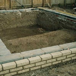 constructing a formal pond with brickwork