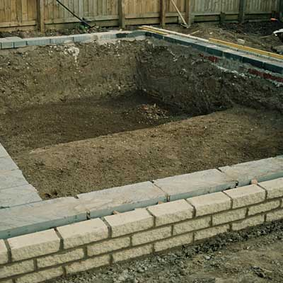 constructing a formal pond with a shelf for plants